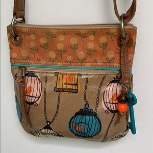 Used Key-per Fossil bird cage purse